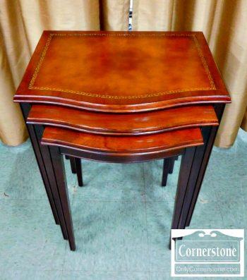 3959-1940 - Nest of 3 Mahogany Leathertop Tables